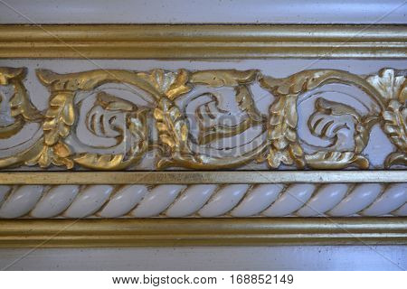 interior detail, gold embossed pattern on the cornice