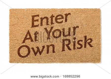 Enter At Your Own Risk Welcome Mat Isolated On A White Background.