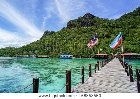 Bohey Dulang,Semporna,Sabah-Sept 10,2016:Jetty at Bohey Dulang,Semporna,Sabah with background of beautiful island of Bohey Dulang on 10th Sept 2016.Bohey Dulang Island is one of the most popular and attraction islands in Tun Sakaran Marine Park.