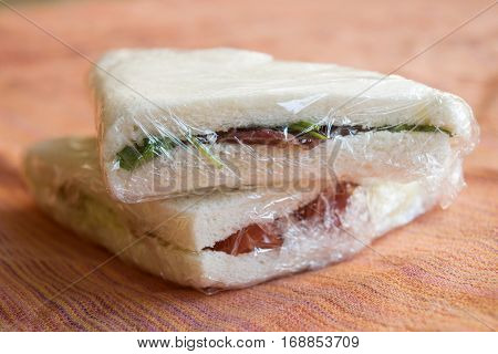 stuffed take away sandwiches wrapped in transparent film