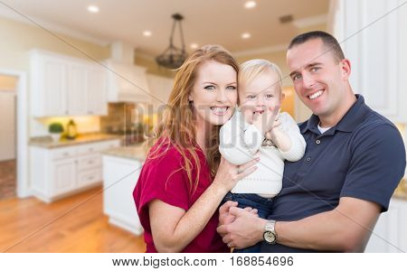 Happy Young Military Family Inside Their Beautiful Kitchen.