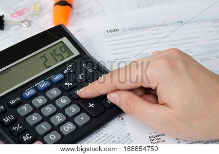 Man Calculates Income Tax