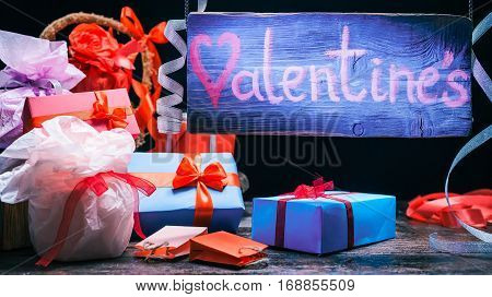 Blue beam on hanging sign above dram shop counter. Valentine gifts assortment. Concept for moving sign of gift store