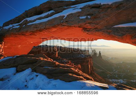 Snow covered Mesa Arch in Canyonlands, Utah