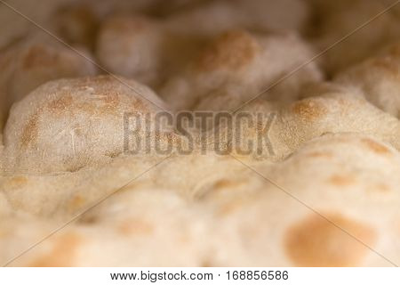 Closeup of focaccia romana bread without ingredients