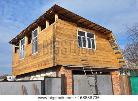 Building wooden second floor extension on garage.