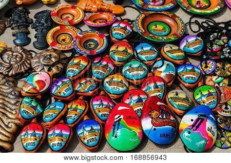 Puno, Peru - October 6, 2016: Peruvian souvenirs and toys on the market
