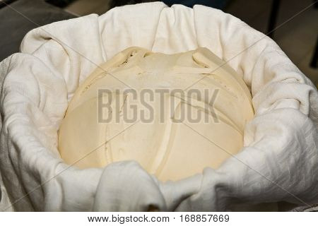 Yeast mother wrapped in a cloth inside a basket
