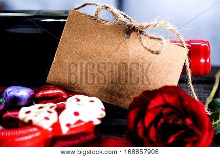 Valentine's day and sweetest concept, red wine with rose. Holiday background with copy space.