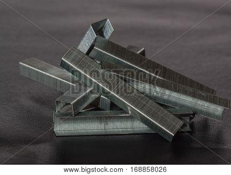 staples for industrial staple gun on a dark background
