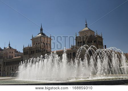 Valladolid (Castilla y Leon Spain): fountain and historic palace in the square known as Plaza de Zorrilla
