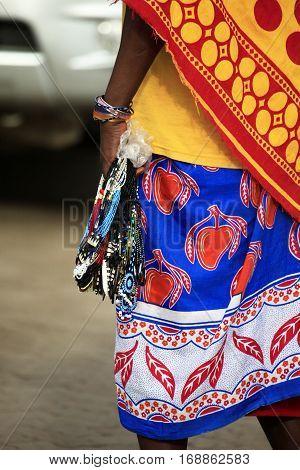 Massai woman sells souvenirs to tourists Kenia