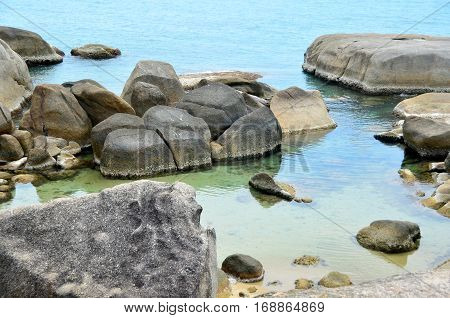 Thailand beach. Large stones and clear water. Samui island.