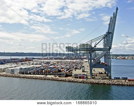 Aarhus, Denmark - June 05, 2009: View of the industrial port of Aarhus from the harbor entrance in the direction of the city. The port of Aarhus has the largest container terminal in Denmark.