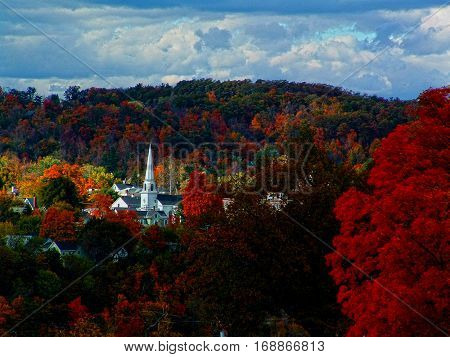 Fall colors and a white church steeple