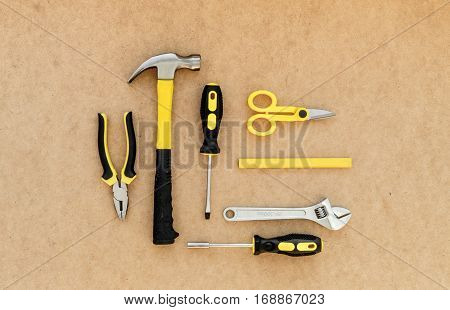 Tools for repairing top view on pasteboard background.