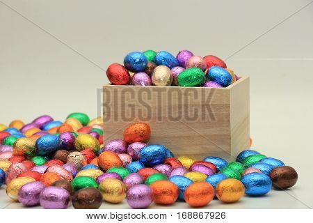 Foil wrapped chocolate easter eggs in a wooden box