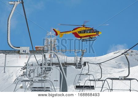 Rescue helicopter on ski resort after avalanche emergency