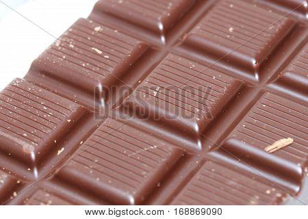 a dark chocolate bar blocks in closeup