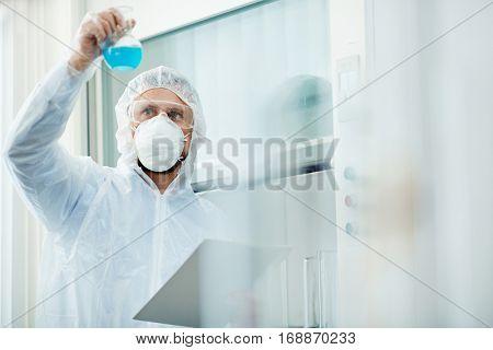 Scientist studying new biohazard substance