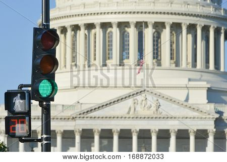 United States Capitol Building with green traffic light foreground that symbolizes a positive decree