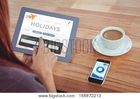 Over shoulder view of hipster woman using tablet against holidays booking app