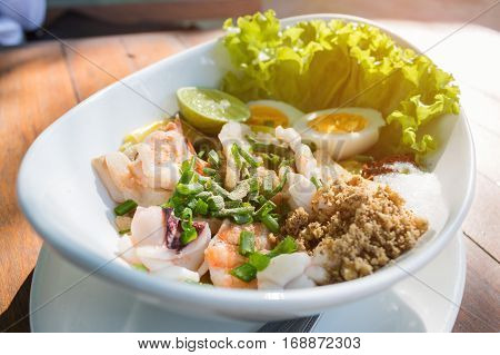 Top view spicy seafood Salad ingredient with squid shrimp fish and egg Thai food.