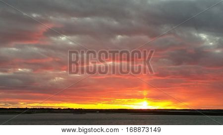 Sun Pillar spiking above the bay at sunset
