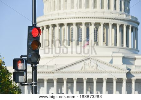 United States Capitol with red traffic light foreground which symbolizes a negative decree - Washington DC USA