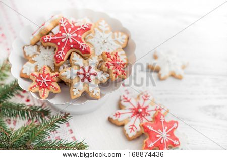 Gingerbread cookies on white wooden background.