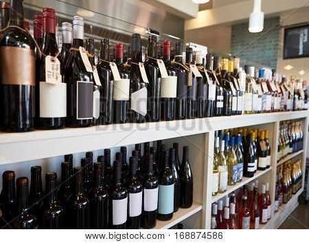 Bottles Of Wine On Display In Delicatessen