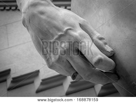 stone statue detail of human hand.