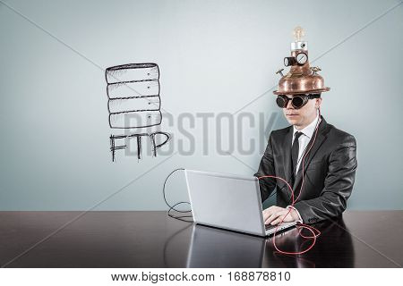 FTP text with vintage businessman using laptop at office