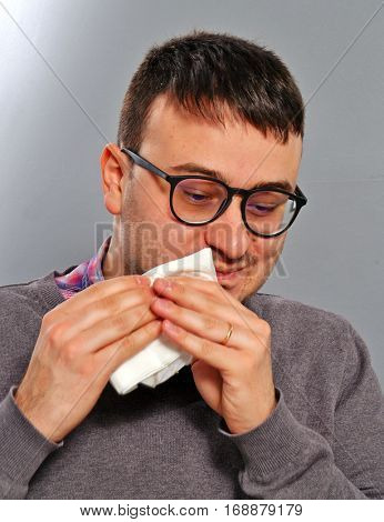 man cleaning mouth after eat.