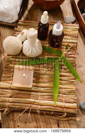 tropical bathspa treatment on mat with wooden background
