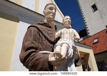 HRVATSKA KOSTAJNICA, CROATIA - JUNE 18: Saint Anthony of Padua statue in front of Parish Church of Saint Nicholas in Hrvatska Kostajnica, Croatia on June 18, 2016.
