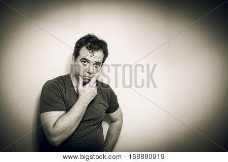 Black and white portrait of a sad man. Vintage style