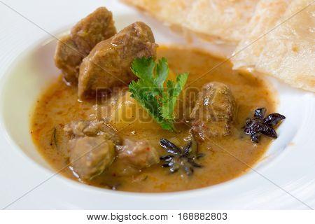 Lamb massaman curry on a white dish