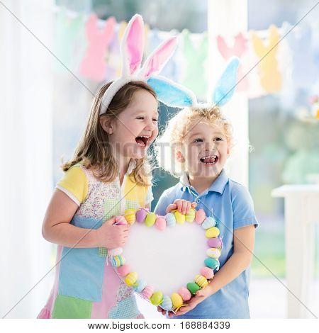 Kids In Bunny Ears On Easter Egg Hunt