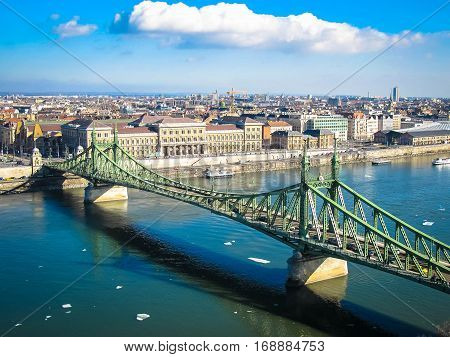 Liberty Bridge (Budapest) in early spring, with the last ice floes on the Danube.