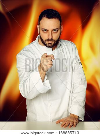 Young Chef On Fiery Background