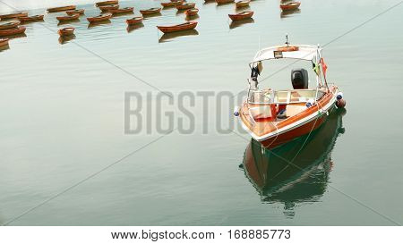 Red Speedboat And Some Recreational Boat On Lake