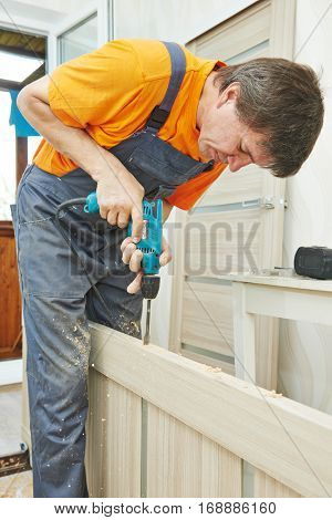 Carpenter works with drill