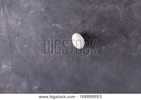 White egg on a gray background. Eggs. Easter photo concept. Copyspace