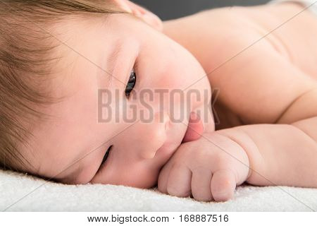 Close Up Picture Of Beautiful Newborn Baby Resting On Blanket