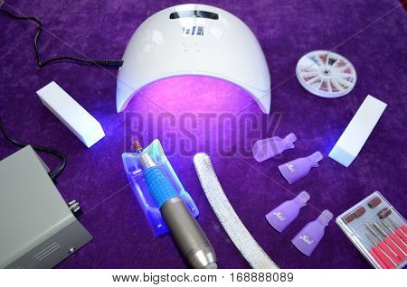 Nail gel salon. Beautiful woman hand and lamp UV  for nails UV with timer