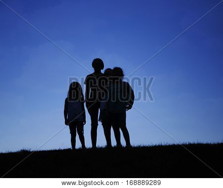 Girls on a hill in a sillouette