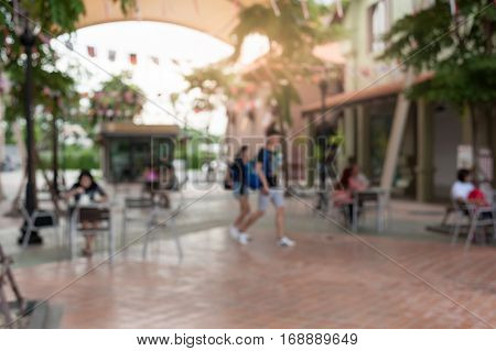 Blurry background of shopping mall. Urban lifestyle on weekend concept