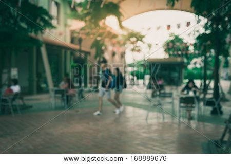 Blurry background of shopping mall. Urban lifestyle on weekend concept with vintage filter effect