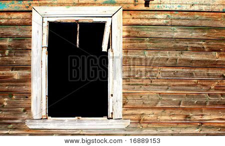 window in abandoned wooden house